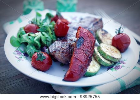 New York steak with vegetables shot outdoor, toned image