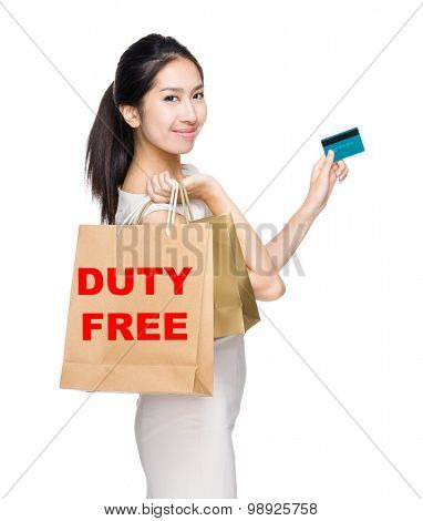 Happy shopping woman credit card and shopping bag for showing duty free