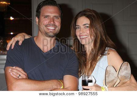 LOS ANGELES - AUG 15:  Joshua Morrow, Amelia Heinle at the