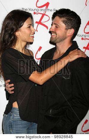 LOS ANGELES - AUG 15:  Sofia Pernas, Robert Adamson at the