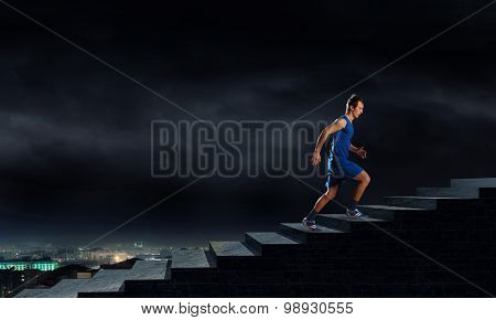 Young man athlete in blue wear running outdoor