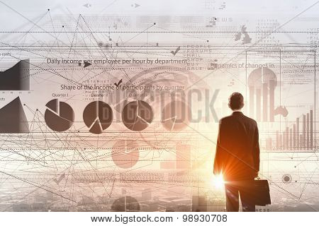 Rear view of businessman with suitcase and diagrams on virtual panel