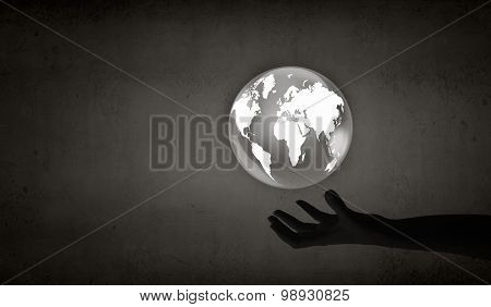 Man's hand holding digital Earth planet representing global technologies concept