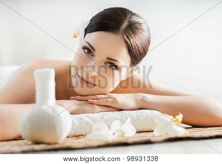 Young, beautiful and healthy woman in spa salon. Traditional oriental aroma therapy and beauty treatments.