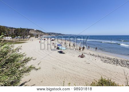 MALIBU, CALIFORNIA, USA - August 15, 2015:  Summer weekend beach goers enjoying Topanga State Beach in Santa Monica Bay.