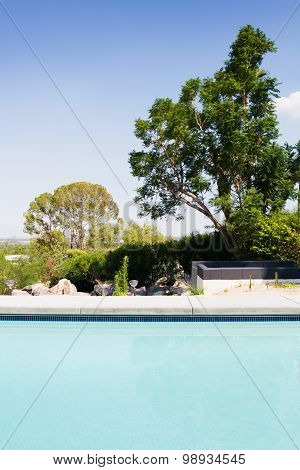 Vertical Blue Swimming Pool With A View Of The Garden