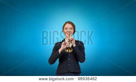 Cheerful businesswoman playing fife on color background