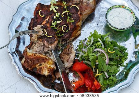 Delicious leg of lamb carved with thyme.