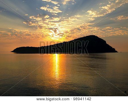 Sunrise Above Small Island Off Thassos In Greece