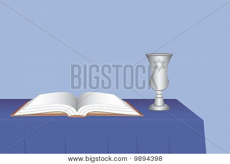 Kiddush Cup with Prayer Book on Table