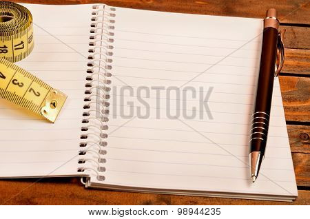 Notepad With Pen And Centimeter