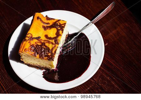 Slice Cheesecake With Blueberry Jam On Plate,brown Table,dessert