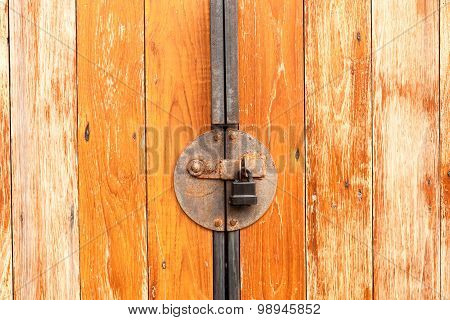 Old Rusty With Padlock On A Wooden Door