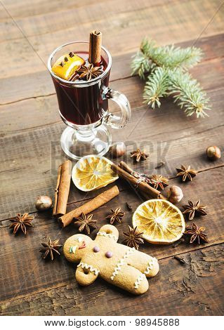 Mulled wine and spices on wooden background. Selective focus