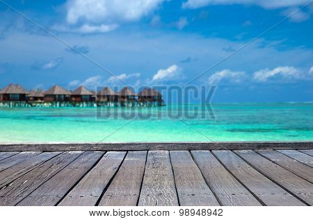 White tropical sea in Maldives with few palm trees and blue lagoon
