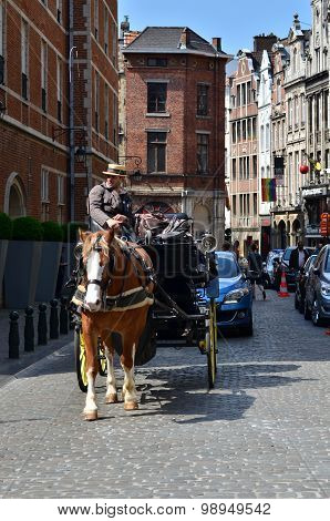 Brussels, Belgium - May 12, 2015: Driver In Traditional Horse Carriage Around The City Of Brussels.