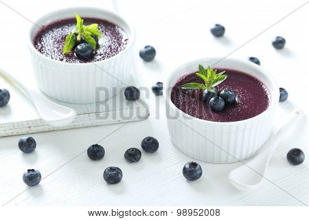 Delicious Blueberry Mousse In Bowls On Wooden Table