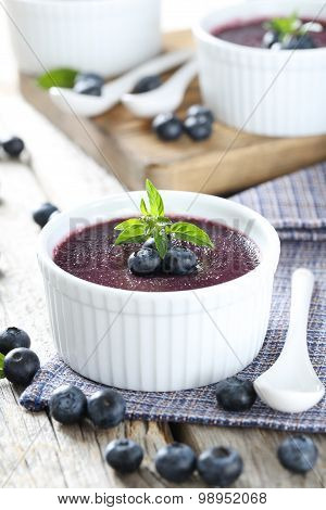 Delicious Blueberry Mousse In Bowls On Grey Wooden Table