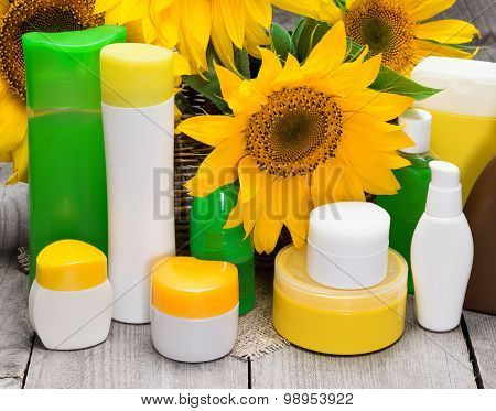 Different Body Care Cosmetics And Sunflowers In Wicker Basket