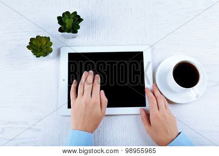 Hands working in the office with tablet on white table