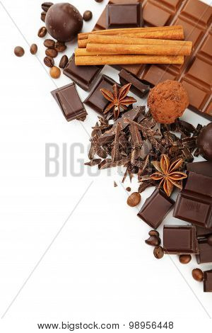 Dark Chocolate Bar With Coffee Beans And Cinnamon On White Background