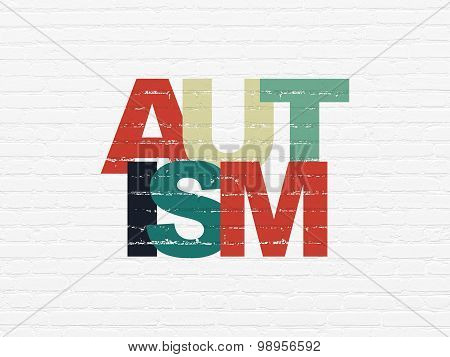 Healthcare concept: Autism on wall background