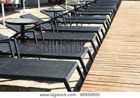 Sunbeds near swimming pool, outdoor