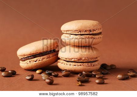 Coffee Macarons With Coffee Beans On Brown Background