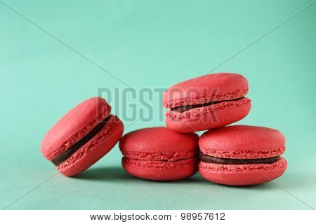Red Macarons On Green Background