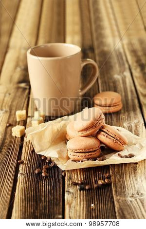 Coffee Macarons With Coffee Beans On Brown Wooden Background