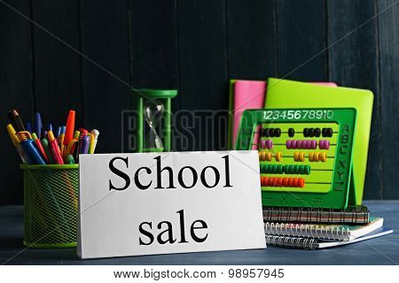 School supplies for sale, on light wall background