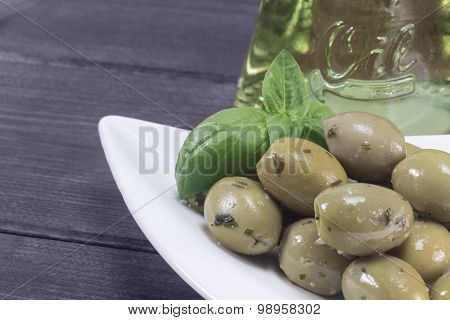 Green Olives With Oil Bottle In The Background