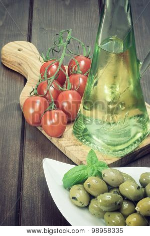 Vintage Photo Of Green Olive Salad, Tomatoes And Oil Bottle