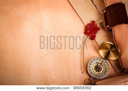 Compass, Ancient Scroll With Red Wax Seal On Old Paper As A Background