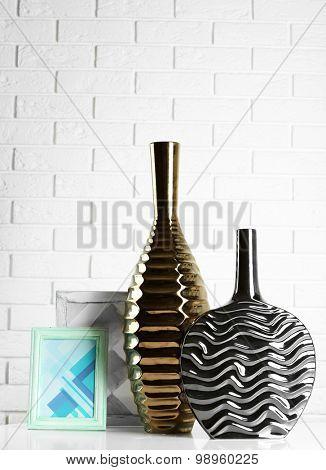 Modern vases on floor in room