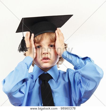 Young tired professor in academic hat on white background