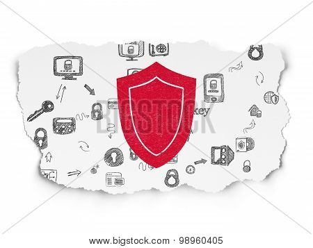 Security concept: Shield on Torn Paper background