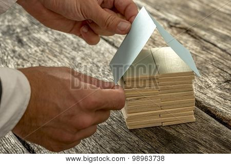 Designer Forming A Miniature Out Of Wood And Paper
