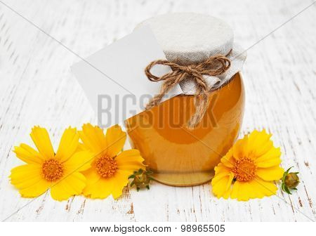 Jar Of Honey With Cosmos Flowers