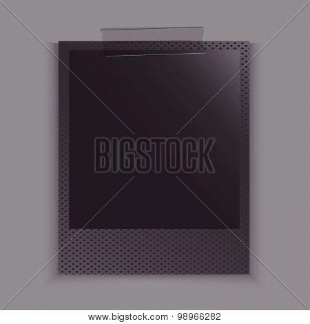 Black old photo frame with sticky tape