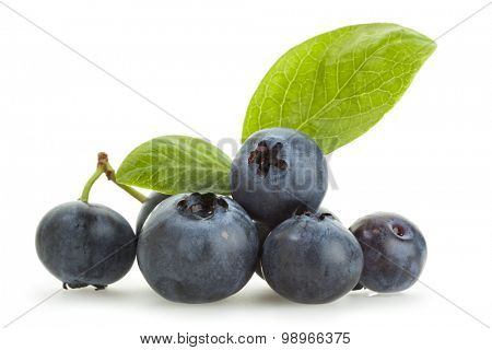 Blueberries isolated on white. Heap of blueberries with their leaves isolated on white background