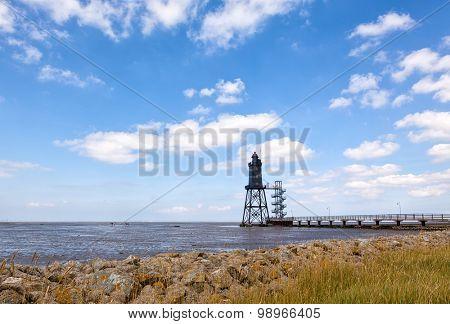 Dorum-Neuwerk lighthouse at the wadden sea, german north sea coast