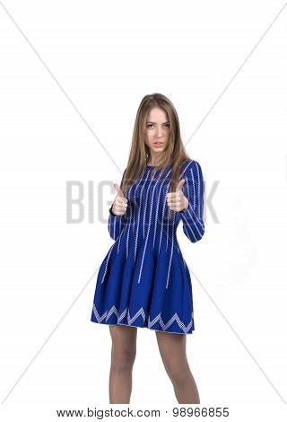 Lady in blue dress makes okay gesture with both hands