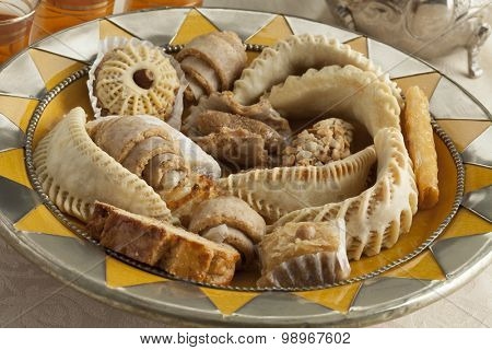 Fresh baked Moroccan cookies on a traditional dish