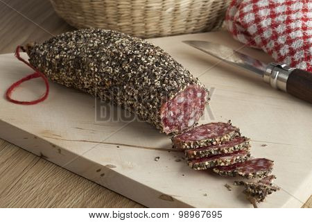 French sausage covered with black and white pepper