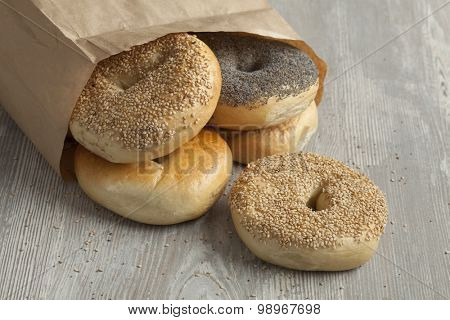 Paper bag with fresh variety of New York bagels