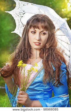Beautiful Young Woman With Long Hair And Umbrella