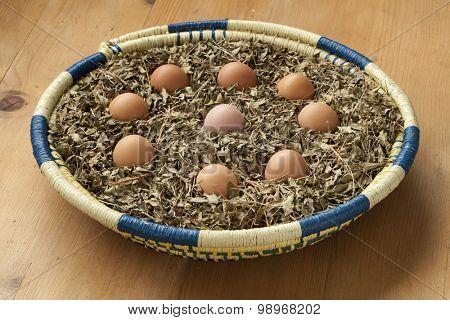 Eggs in a basket with dried henna leaves as a symbol for a Moroccan wedding party