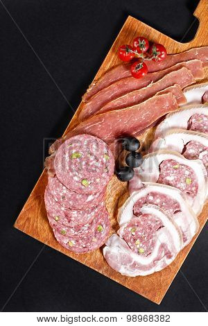 Delicasy Cervelat And Hamon Slices On Cutting Board