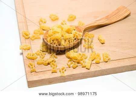 Pasta In The Form Of Animals And A Spoon On A White Background